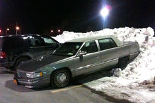 car parked on snowbank