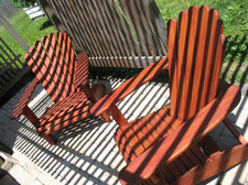 adirondack chairs under a pergola