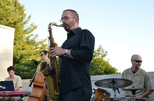 Thumbnail image for brian patneaude quartet playing on roof