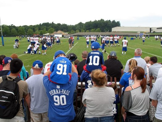 people watching the Giants practice at UAlbany