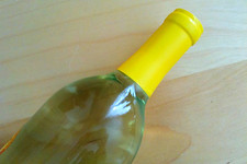 Thumbnail image for wine bottle top against table