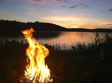 campfire at a lake