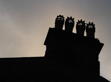chimneys silhouetted by Flickr jayneandd