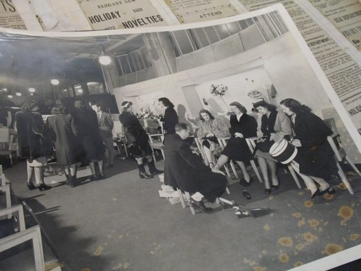 frear building historical photo women trying on shoes