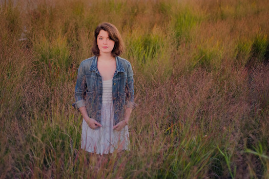 MaryLeigh Roohan standing in field 2013