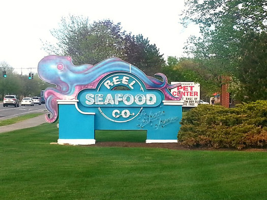 Reel Seafood Co Wolf Road sign