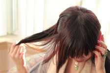 asian woman playing with her hair