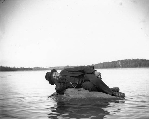charles steinmetz on a rock in thompson's lake
