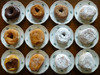 bella napoli dozen donuts on plates