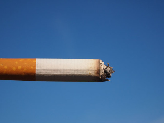cigarette against a blue sky Flickr user Fried Dough CC