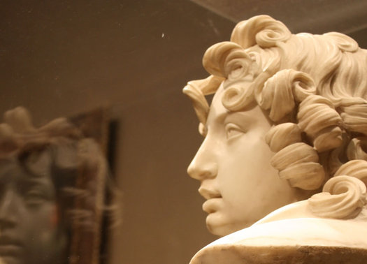 statue with curly hair