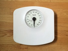 bathroom scale on wood floor