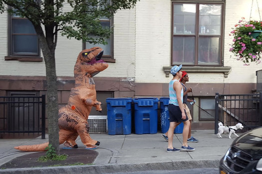 dinosaur walking down Lark Street