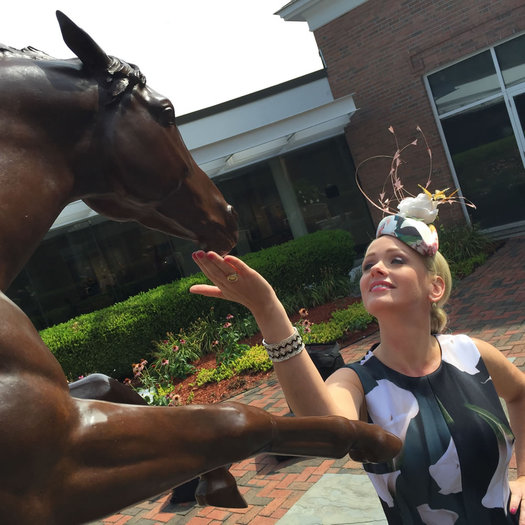 kate welshofer fascinator with horse statue