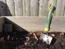 garden shovel in dirt