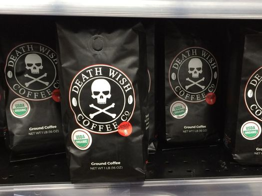 bags of death wish coffee on supermarket shelf