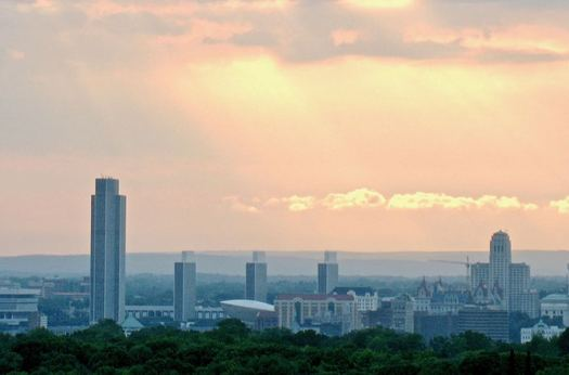 Albany skyline from E Greenbush sunset background