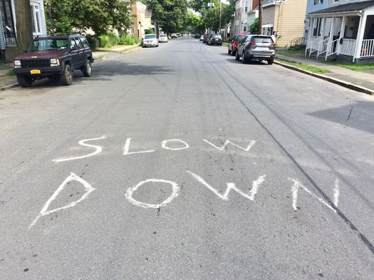 Slow Down on pavement of 3rd Street Albany