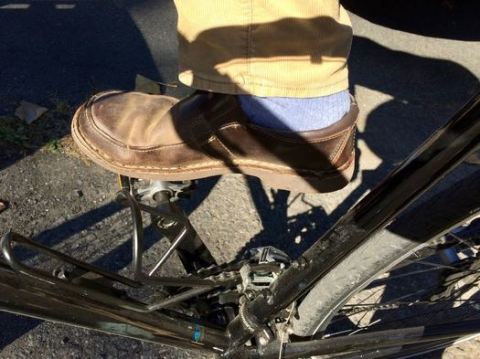 shoe on bike pedal