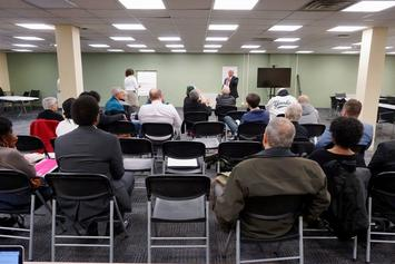 Albany police chief search forum 2018-04-16 behind crowd