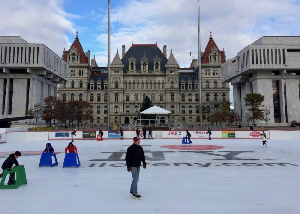 Empire State Plaza ice rink 2017-Dec Capitol background