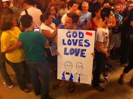 supporter with sign God loves love