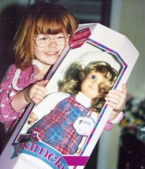 LHittinger on Christmas morning with Pamela doll.jpg