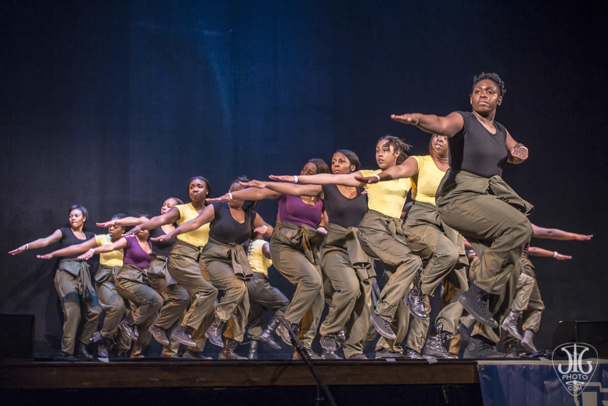 Palace step show arms outstretched