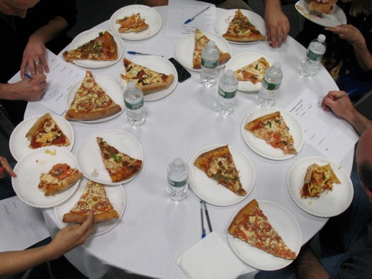 16 slices of pizza on judges table