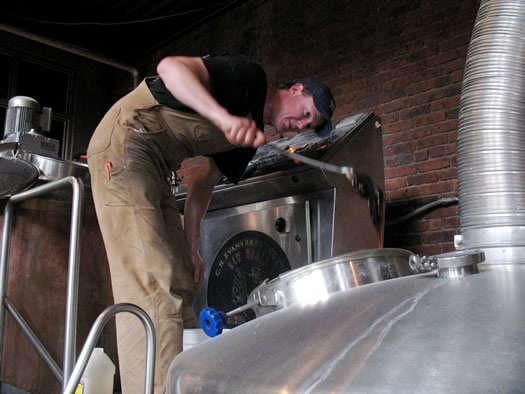 ryan demler adding invert sugar to a tank