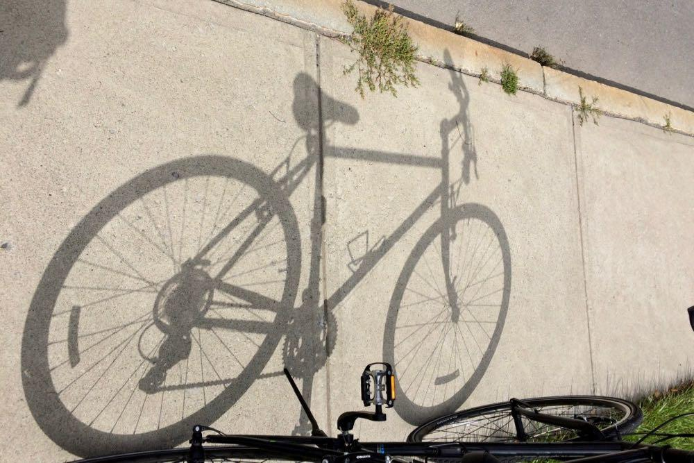 bike shadow on sidewalk
