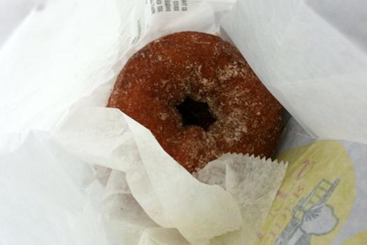 cider donut nestled in bag