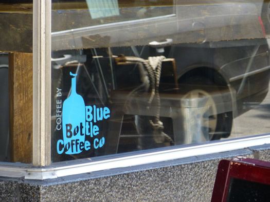 confectionery blue bottle sign
