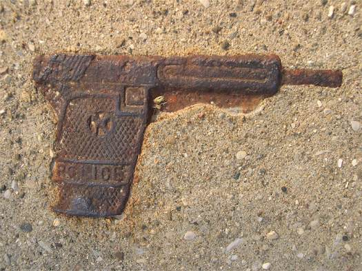 gun encased in concrete