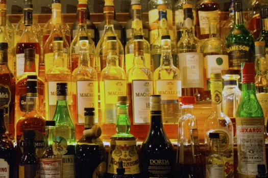 liquor bottles behind Malt Room bar