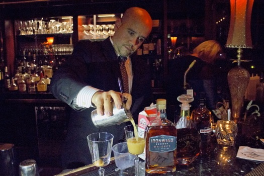 holiday_cocktails_677_Jamie_Ortiz_pouring_drinks.jpg