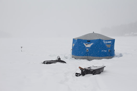 ice_fishing_shanty_on_snowy_lake.jpg