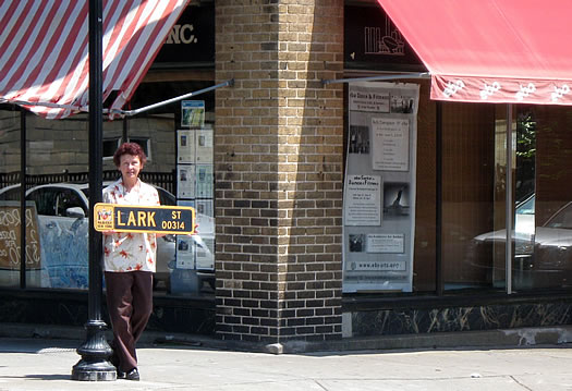 maude baum holding lark street sign