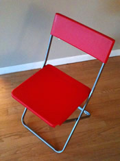 one red foldup chair