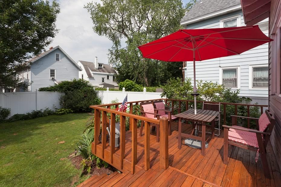 open_house_pine_hills_modern_deck_yard.jpg
