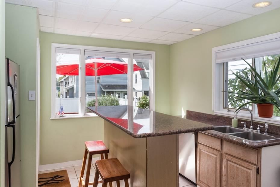 open_house_pine_hills_modern_kitchen_back_window.jpg