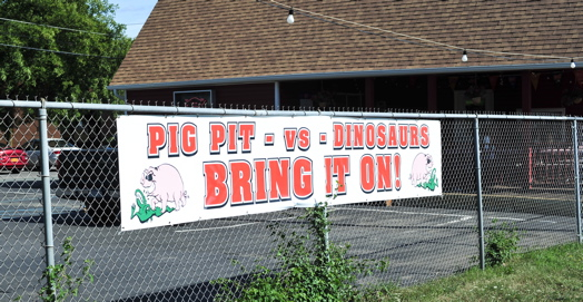 pig pit vs dino sign.jpg
