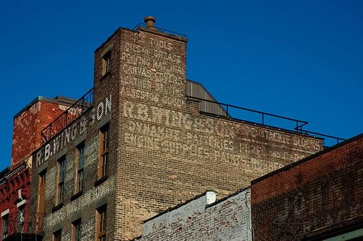 rb wing and son building ghost sign