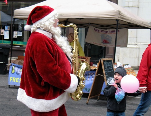 santa playing sax troy victorian stroll