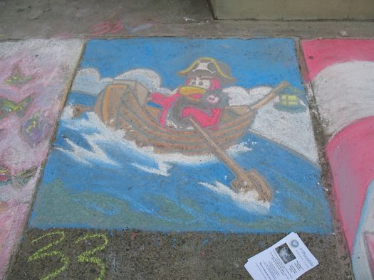 sidewalk art bird in a boat