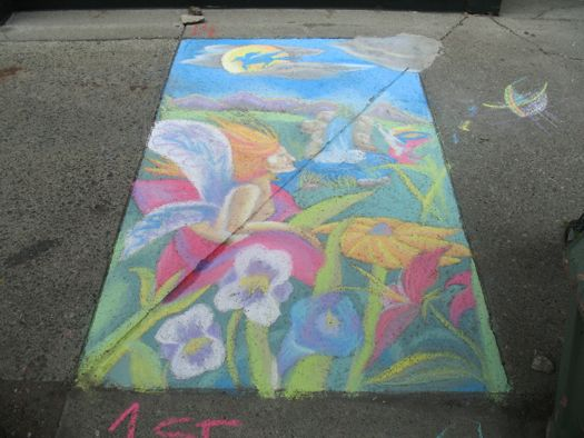 sidewalk art of a nymph in a flower with a waterfall