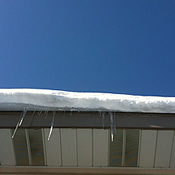 snow hanging from roof
