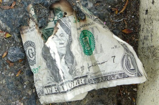 tattered dollar bill
