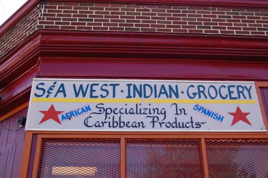 west indian grocery exterior sign