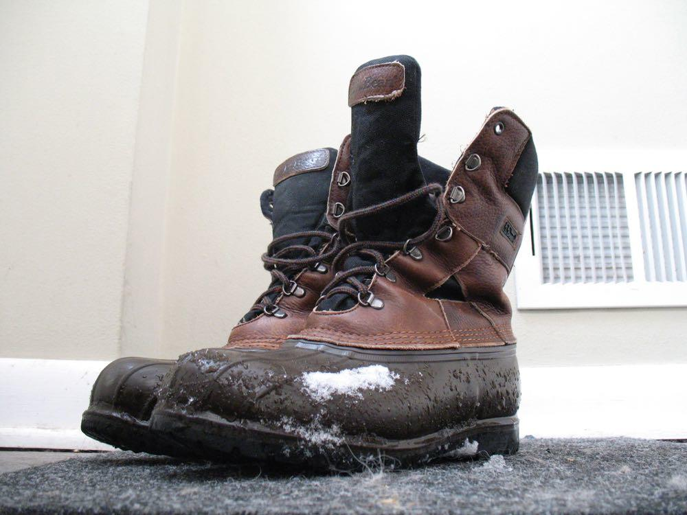 winter boots with snow on them